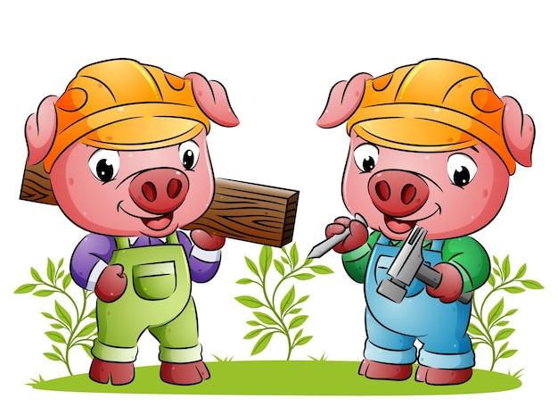 De bouwvarkens houden de houten plank en de hamer van de illustratie vast