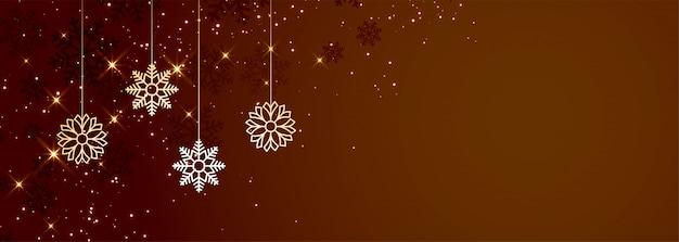 De bruine banner van kerstmissneeuwvlokken met copyspace