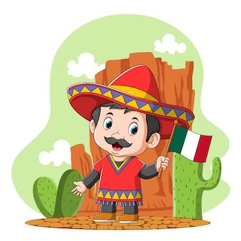 De cartoon van een mexicaanse jongen gebruikt de sombrero in de woestijn