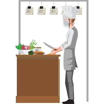De chef-kok snijdt groenten voor het koken van ingrediënten