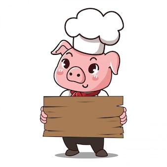 De chef-kok van het varken houdt een teken met ruimte om uw bericht neer te leggen.