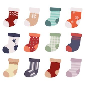 De collectie sokken op de witte achtergrond.