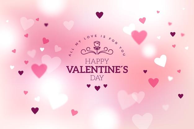 De dag vage achtergrond van de roze valentijnskaart met harten