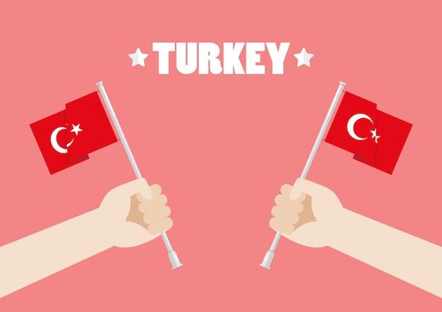De dag van de republiek van turkije met handen die de vlaggen van turkije steunen
