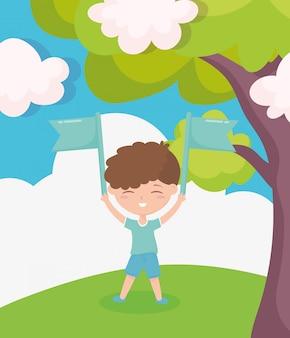 De dag van gelukkige kinderen, jongetje die met gras van de vlaggenbeeldverhaal in openlucht boom spelen