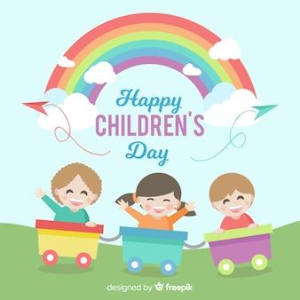 De dagachtergrond van gelukkige kinderen met jonge geitjes aan de gang en regenboog