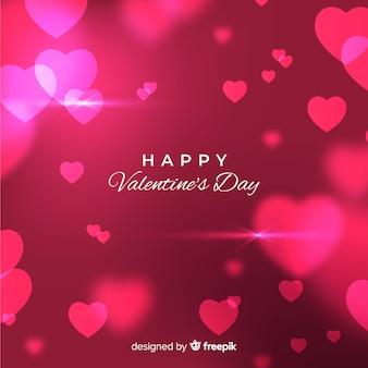 De dagachtergrond van vage glanzende harten valentijnsdag