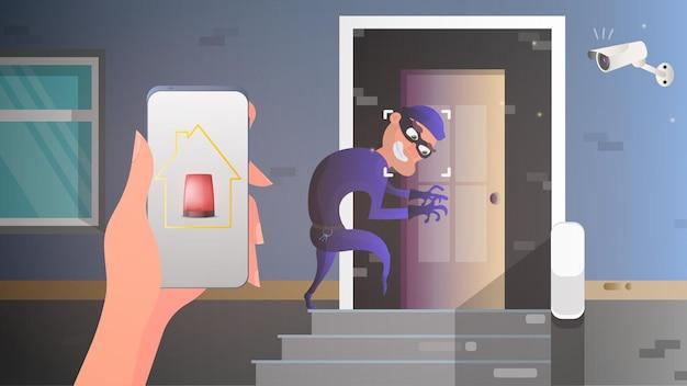 De dief probeert via de deur het huis binnen te komen. veiligheid in huis. waarschuwing. veiligheids- en beveiligingsconcept.