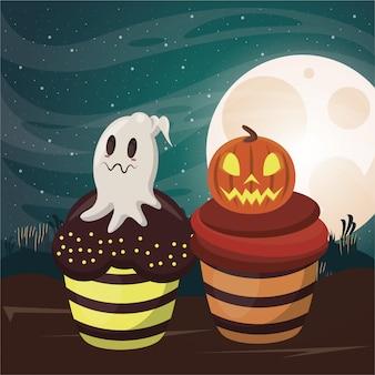 De donkere scène van halloween met zoete cupcakes