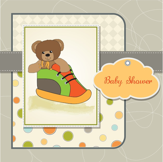 De douchekaart van de baby met teddybeer die in een schoen wordt verborgen