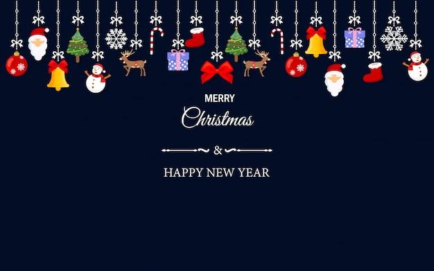 De elementen die van het kerstmisornament op behangachtergrond hangen.