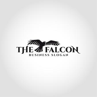 De falcon is een vogelembleem met een vliegend valkconcept