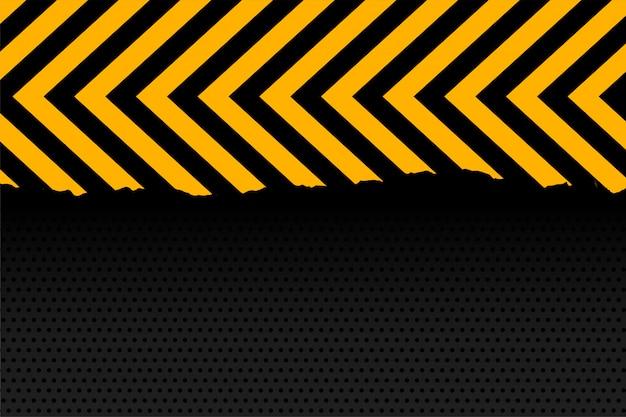 De gele en zwarte achtergrond van pijlstrepen