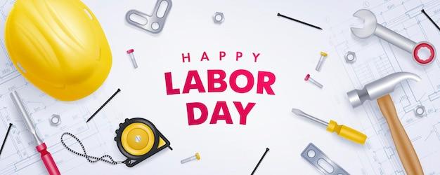 De gelukkige banner van de arbeidsdag met gele helm en hulpmiddelen