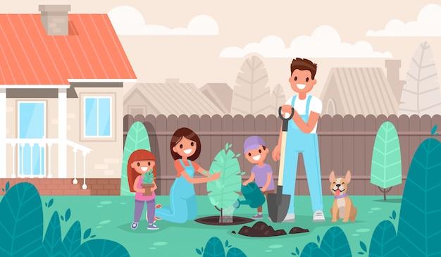 De gelukkige familie plant een boom in de tuin. ouders en kinderen rusten in een landhuis in de natuur