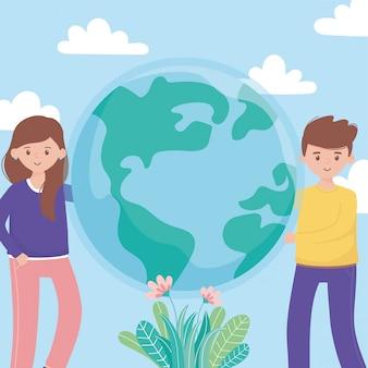 De gelukkige jongen en het meisje met het gebladerte van wereldbloemen beschermen aard en ecologieconcept