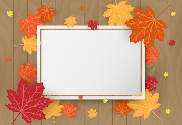 De gelukkige kaart van de thanksgiving dayviering met de oranje bladeren van de esdoornherfst op houten