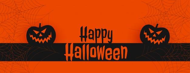 De gelukkige oranje banner van halloween met pompoenen en spiderweb
