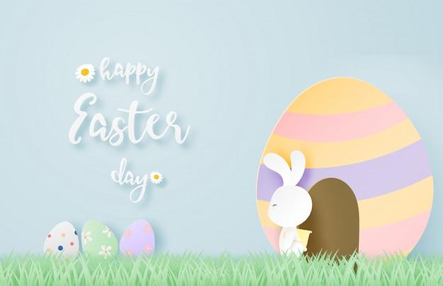 De gelukkige pasen-dagachtergrond met konijntje en eieren in document sneed stijl.