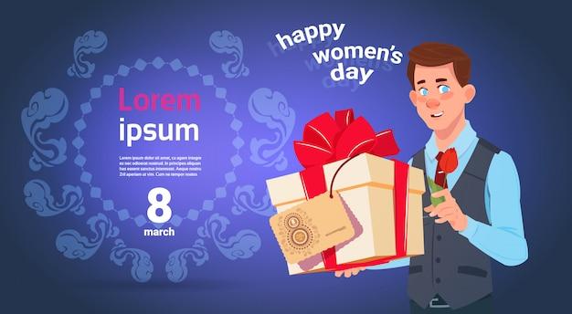 De giftdoos van de mensengreep voor gelukkige de vrouwengroetkaart van de 8 maartvakantie over de malplaatjeachtergrond