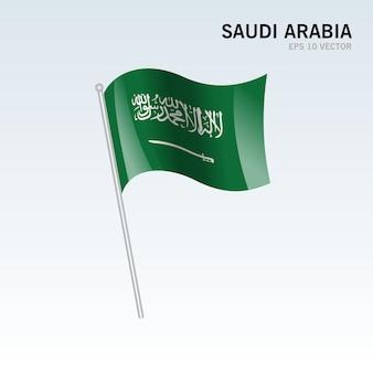 De golvende vlag van saudi-arabië die op grijze achtergrond wordt geïsoleerd