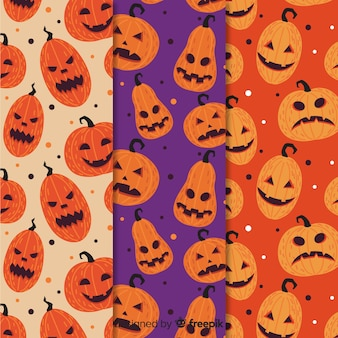 De grappige halloween-pompoen ziet patrooninzameling onder ogen