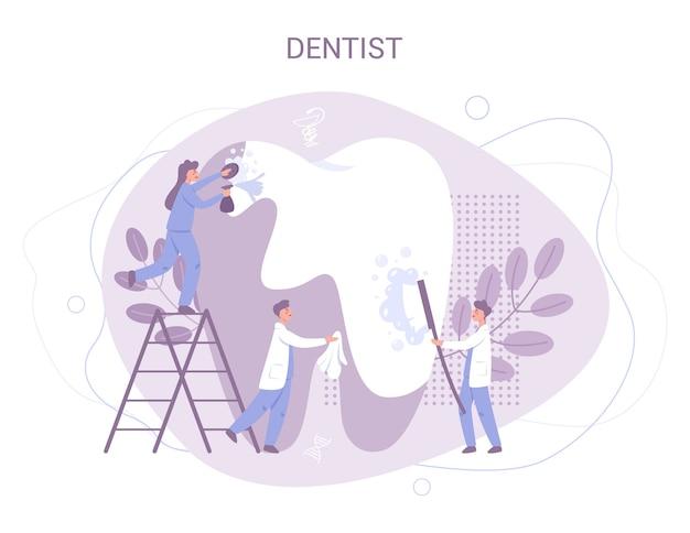 De groep kleine tandartsen in uniform behandelt reuzetand met behulp van medische apparatuur