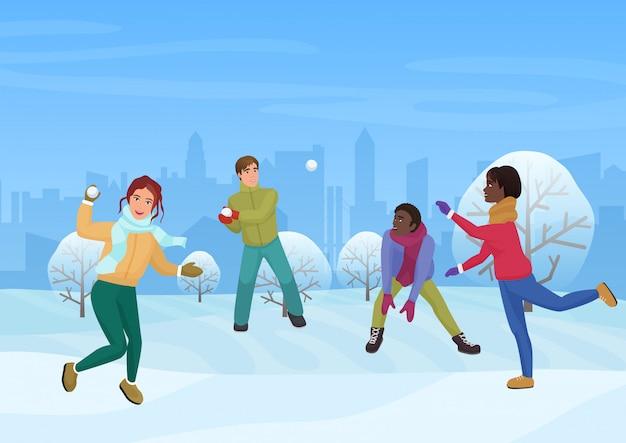De groep vrienden die de sneeuwballen speelt