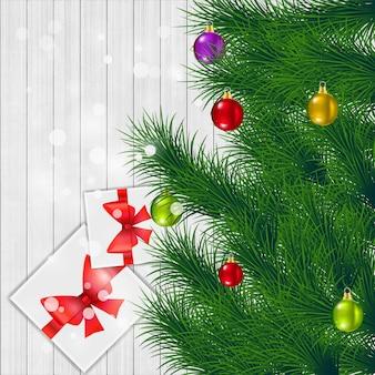 De groetkaart van kerstmis op witte houten achtergrond.