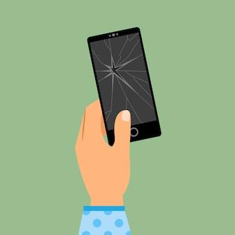 De hand die van de vrouw gebroken smartphone houdt