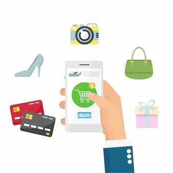 De hand die van de zakenman online door contant geld en creditcard winkelt door smartphone.