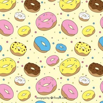 De hand getekend gekleurde donuts patroon