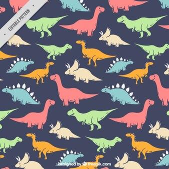 De hand getekend gekleurde soort dinosaurussen patroon