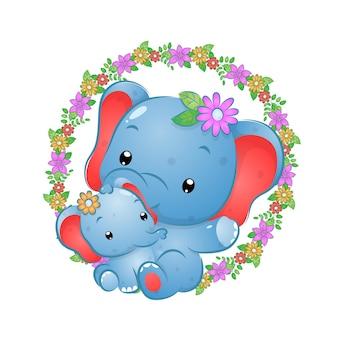 De hand getekend van de twee olifanten zittend op de bloemenringen van illustratie