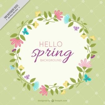 De hand getekende bloemen krans lente achtergrond