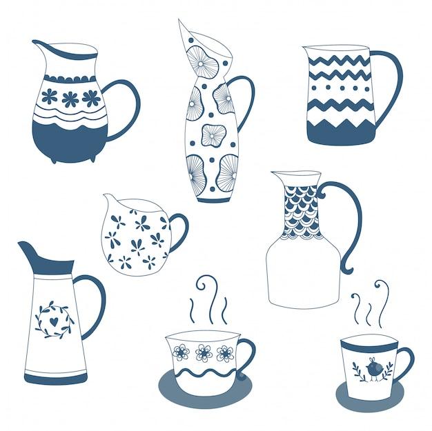 De hand getrokken blauwe porseleinen theepot en koppen van de krabbelhand. vector ontwerp.