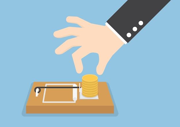 De hand van de zakenman probeert om geld van muizeval te plukken