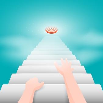 De handen van de persoon kruipen de trap op die naar het doel leidt.