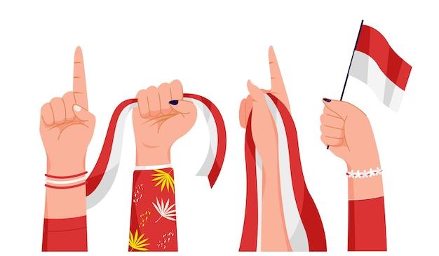 De handen van vrouwen met de vlag van indonesië