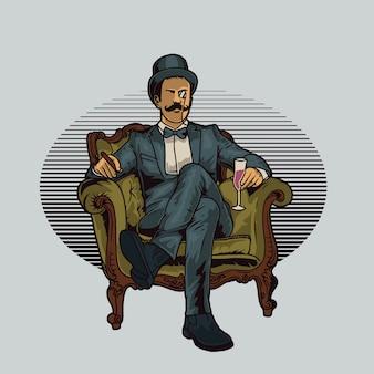 De heer zit op de stoel met een drankje