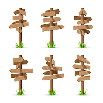 De houten lege reeks van pijluithangborden Premium Vector