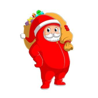 De illustratie van de kerstman die de persoonlijke beschermingsmiddelen gebruikt en de grote zak met geschenken vasthoudt