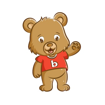 De illustratie van de kleine pop met het ontwerp van de beer staat en zwaait met zijn hand om gedag te zeggen
