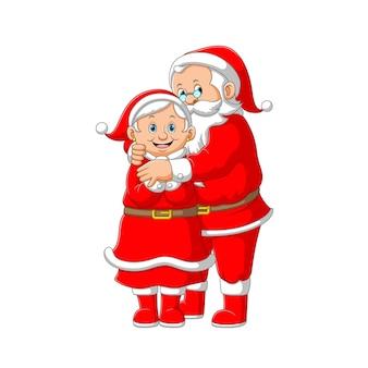 De illustratie van de oude mensen oma en opa die het rode kostuum gebruiken om kerstmis te vieren