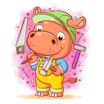 De illustratie van het oranje nijlpaard gebruikt de groene helm rond het gebruiksvoorwerp