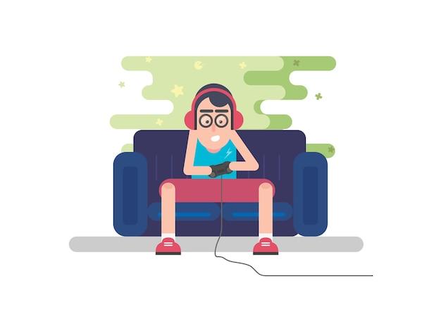 De jonge joystick van de jongensholding en het spelen van spelen