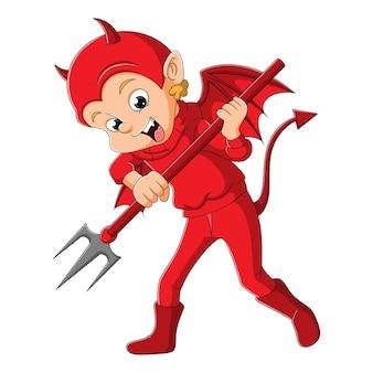 De jonge man met het duivelskostuum houdt de drietand van de illustratie vast