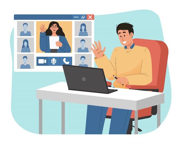 De jonge mens spreekt op webconferentie met zijn collega's die laptop met behulp van