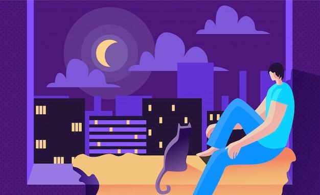 De jonge mens zit bij nacht op venster en kijkt maan.