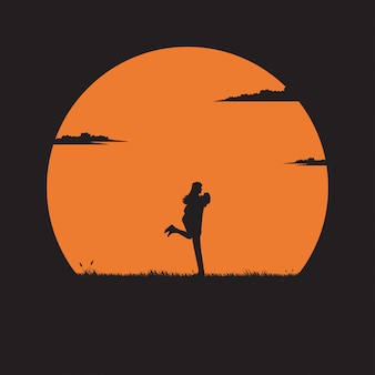 De jonge paren bevinden zich koesterend elkaar op de weide met een zonsondergangachtergrond